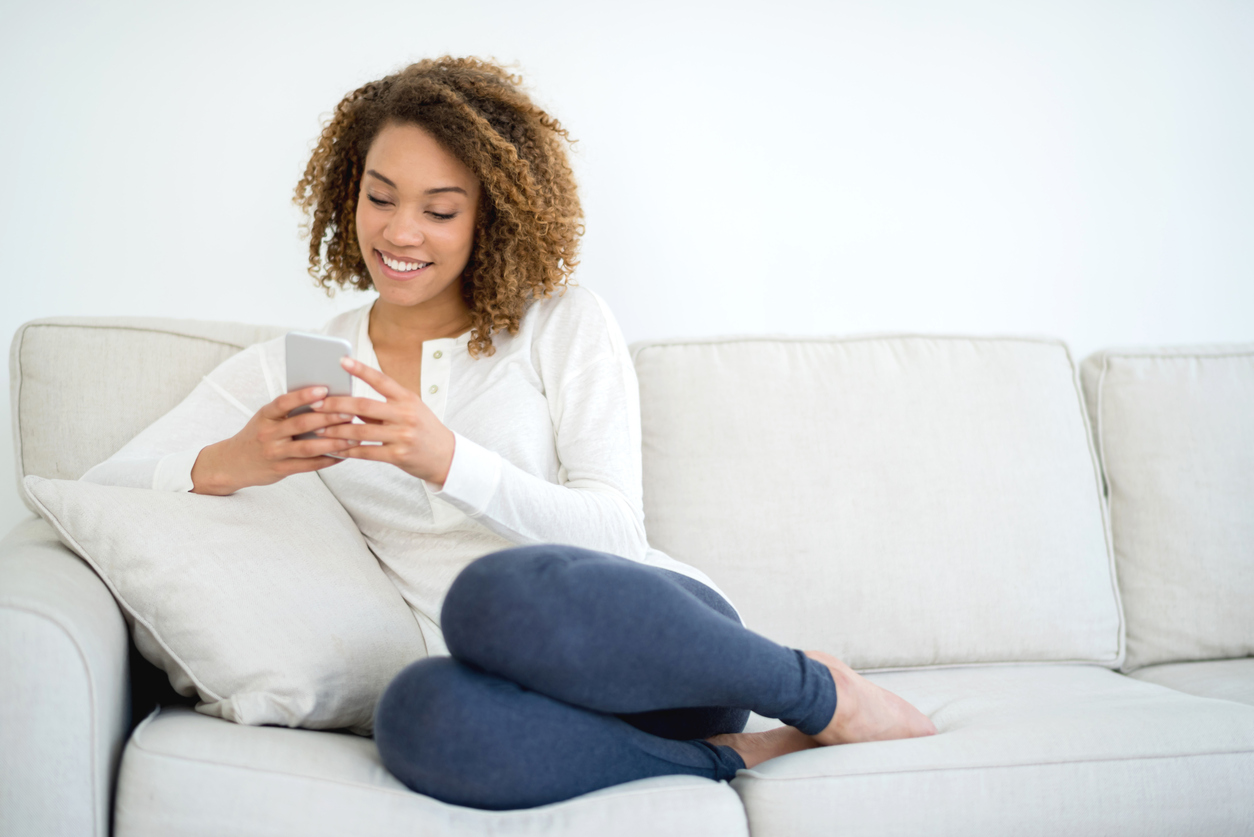 Woman At Home Texting On Her Phone Cleanfax
