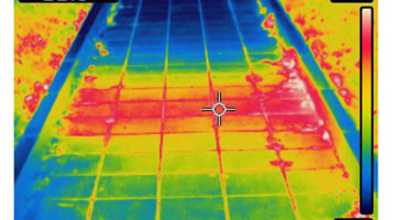 thermal imaging of heated surface from underground hot water pipe. Colors represent various temperatures, defined with rainbow Celsius scale on right side of image. Temperature on upper left corner is a temperature of a point where cursor is. Photo is taken with Flir T420 infrared camera.