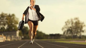 businesswoman on track running the second mile in business