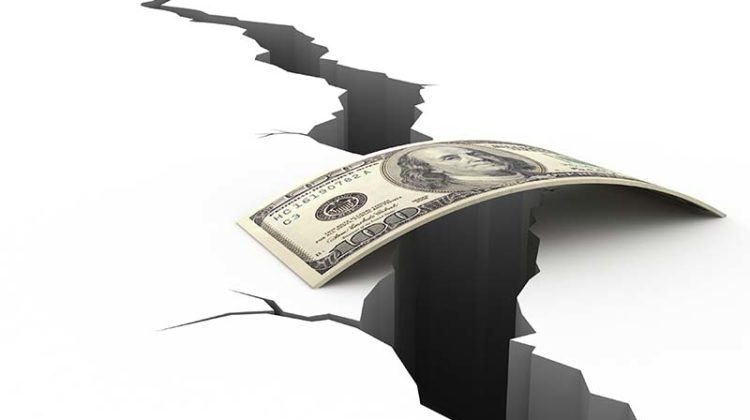 Loans During the Pandemic represented with money over fissure